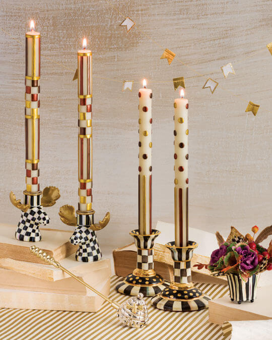 Present our candles in their best light and with the style of MacKenzie-Childs with our candle holders and accessories. Our versatile candlesticks elevate the style of every setting—whether they're displayed singly or grouped to add delightful dimension.