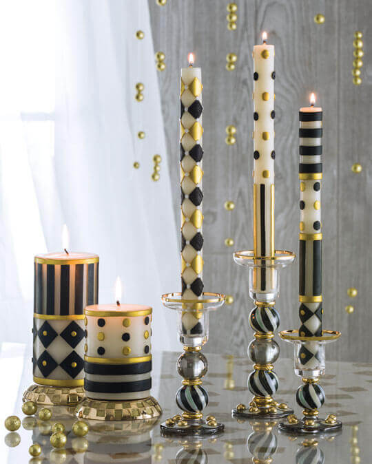 Add a touch of MacKenzie-Childs to your dining table with our pillar and dinner candles. Made from a blend of waxes and hand decorated with our unique blend of patterns that includes checks, stripes, and dots, they make any setting good to glow.